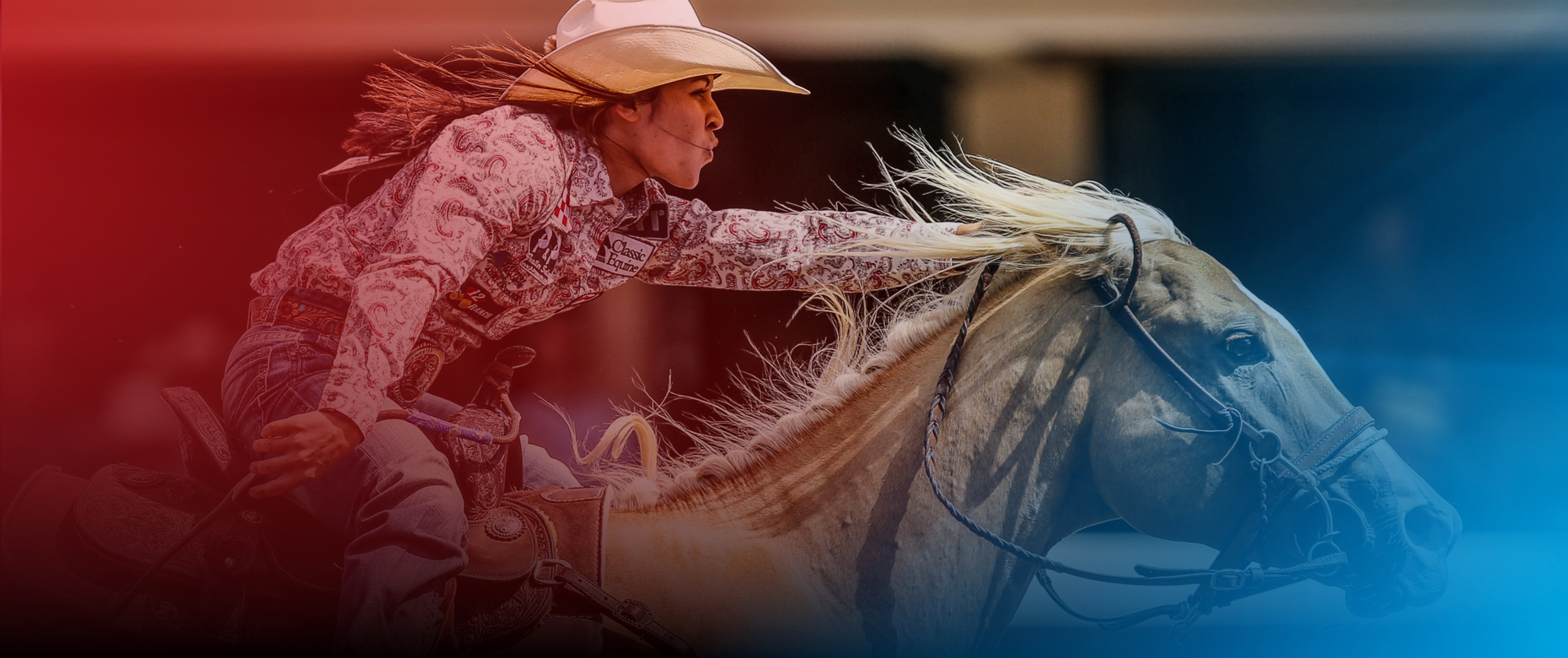 Hailey Kinsel barrel racing at the Calgary Stampede